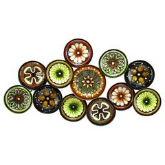 Metal Wall Decor With Colorful Flowers Over Round Base