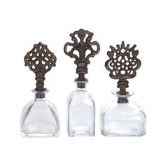 Benzara Transparent Tuksan Manhattan Bottle Set
