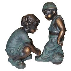 Benzara Girl Fixing Boy's Shoe Lace Statue