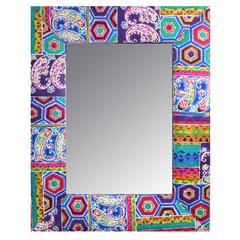 Uniquely Designed Wood And Fabric Framed Mirror