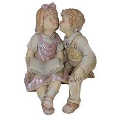Benzara Awe-Looking Fancy Statue Boy & Girl