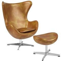 Gold Leather Swivel Egg Chair with Tilt-Lock Mechanism and Ottoman