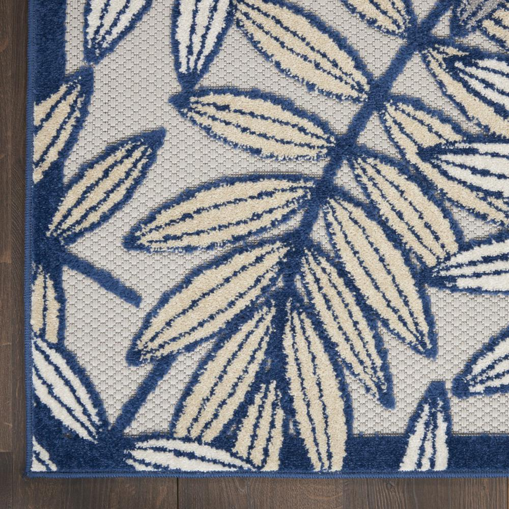 6' x 9' Ivory and Navy Leaves Indoor Outdoor Area Rug - 384884. Picture 2