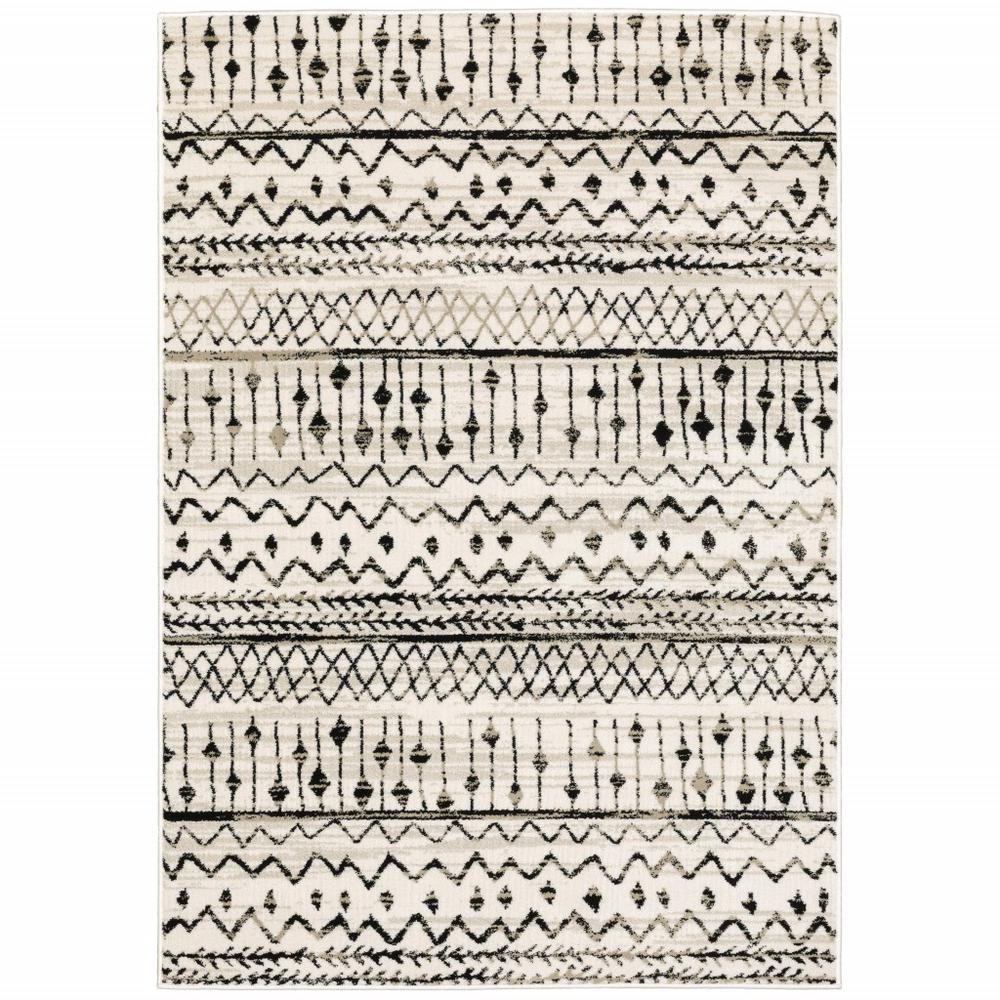 7' x 9' Ivory and Black Eclectic Patterns Indoor Area Rug - 388044. Picture 1