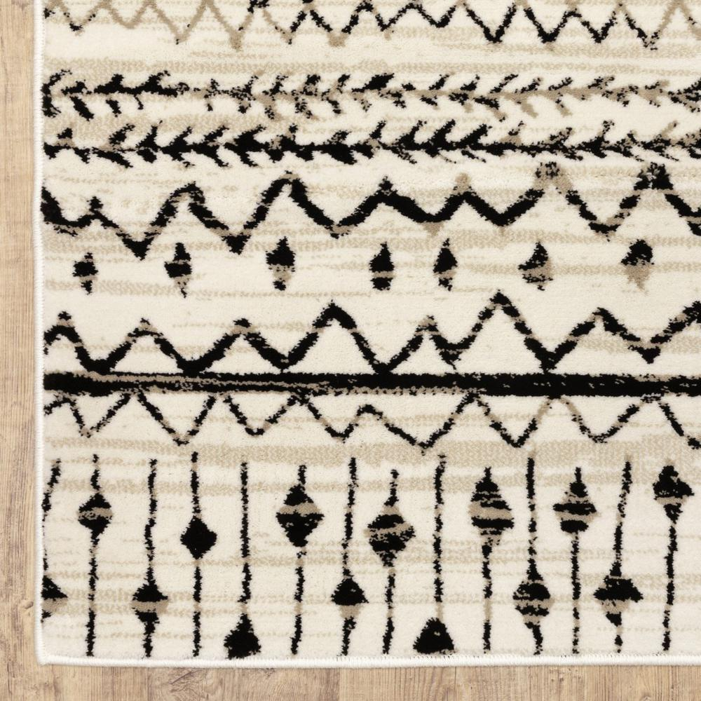 7' x 9' Ivory and Black Eclectic Patterns Indoor Area Rug - 388044. Picture 2