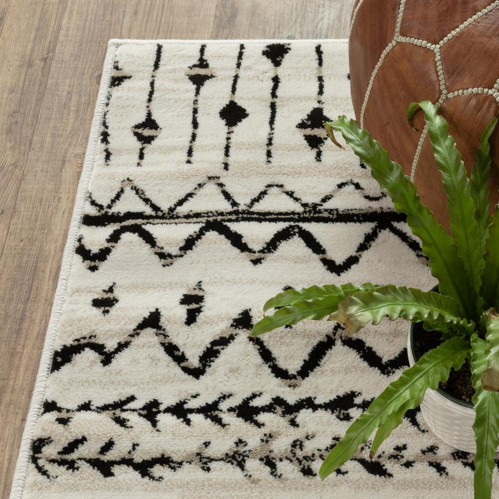 7' x 9' Ivory and Black Eclectic Patterns Indoor Area Rug - 388044. Picture 3