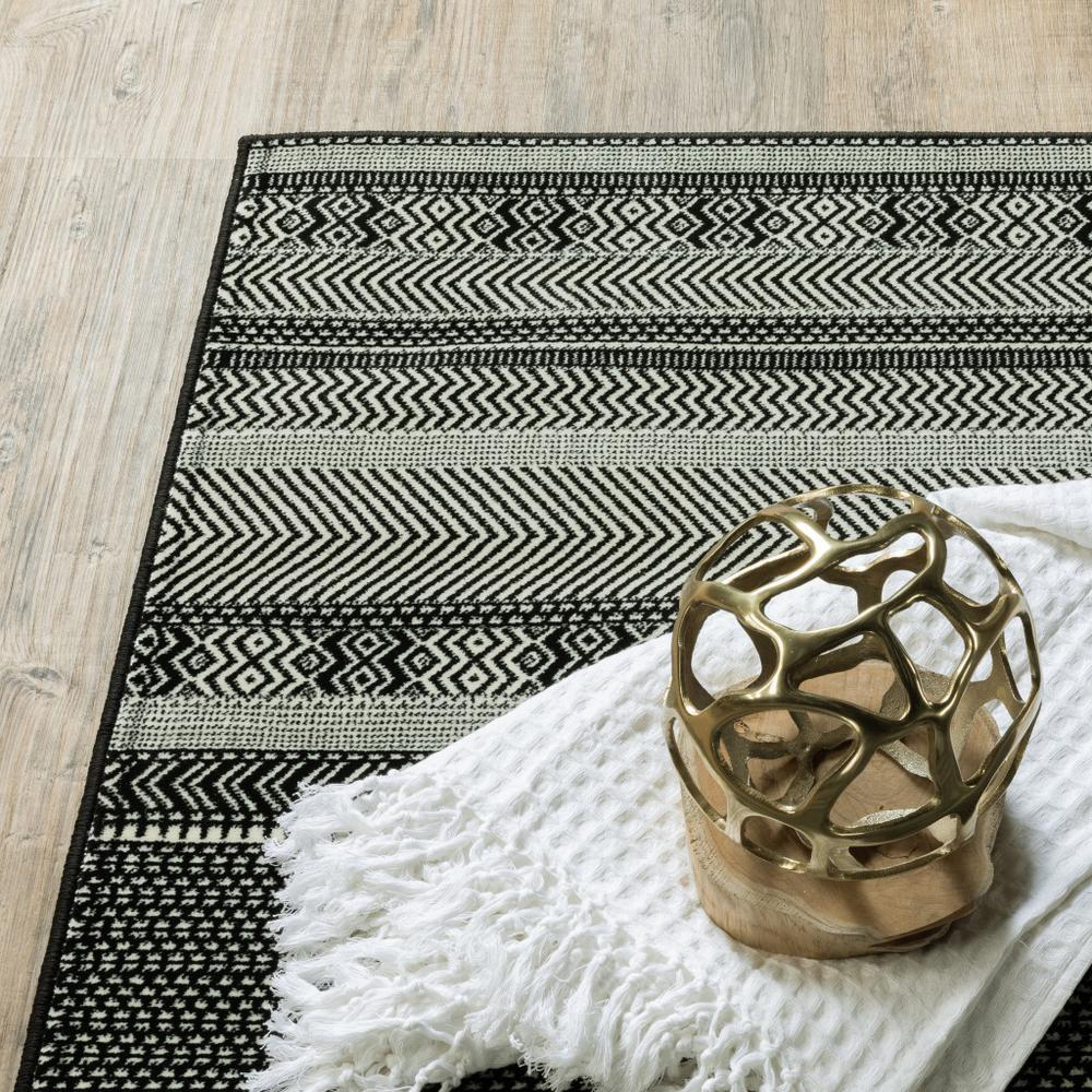 7' x 10' Black Ivory Machine Woven Geometric Indoor Area Rug - 388292. Picture 2