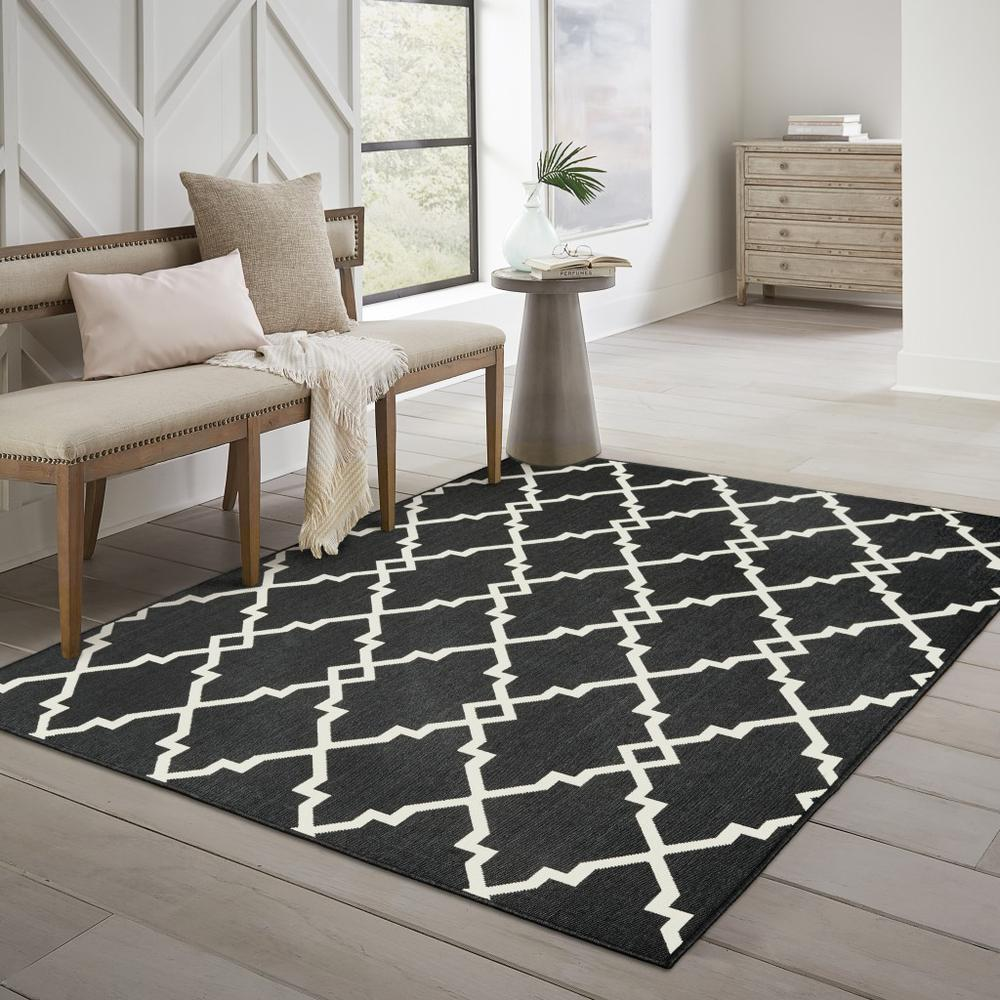 8'x11' Black and Ivory Trellis Indoor Outdoor Area Rug - 389535. Picture 6